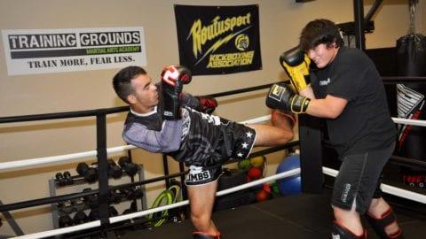 Carter Evans and Ezequiel Soleto practice kickboxing