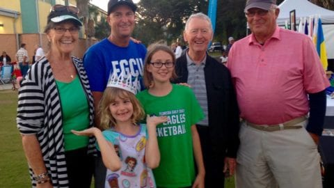 Caitlyn Masters with Don Eslick and family members at the Village of Estero 3rd Anniversary Celebration