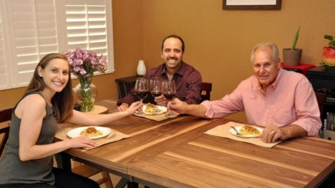 Jamie and Juan Homez toast to a good meal in their Estero home with Rob Kircher