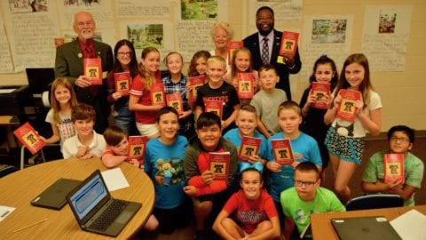 Fifth grade students at Three Oaks Elementary show off their Constitution booklets
