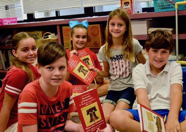 Three Oaks Elementary students study their Constitution booklets