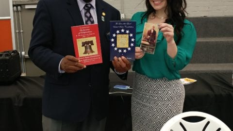 Cofield-Joseph-and-Maria-sharing-booklets-6-2-2018