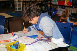 A second grade student works on math