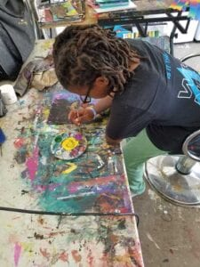 Nalin Isme paints in his home studio