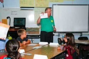 JA-volunteer-and-'evangelist'-Jim-Shields-teaches-a-lesson-in-economics-at-Pinewoods-Elementary