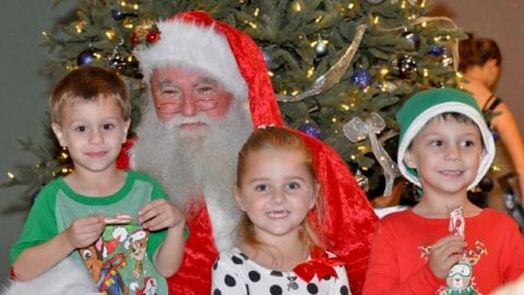 Santa (Dave Ott) with Lucas and Nicholas Levesque and Melanie Ward