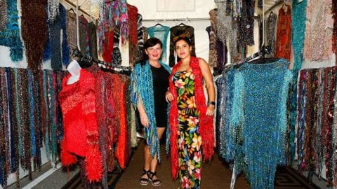 Fiber artist Inna Schoeler with Boca Raton fine artist Diana Ratevosian, modeling some of Schoeler's creations at the Coconut Point New Year's Art Festival