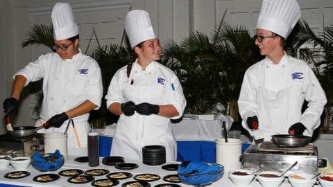 Freddy-Figueroa,-Callie-Layne-and-Tyler-Thompson-prepare-crepes