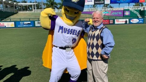 President of Estero Life Magazine Gary Israel poses with Fort Myers Mighty Mussels Mascot