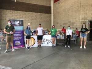 Normal is Overrated students collect food donations at Costco in partnership with Kids' Minds Matter