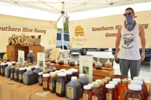 Jordan Miller sells local honey for Southern Hive Honey Company at Miromar Outlets Farmers Market
