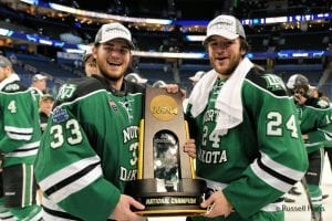 Cam Johnson and Christian Wolanin celebrate a North Dakota championship