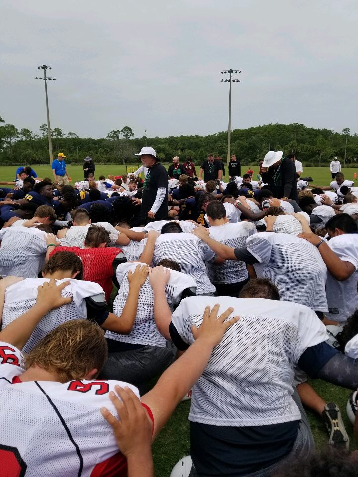 Coach V leads athletes in prayer