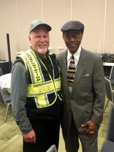 Kevin Van Duser with football great Gale Sayers