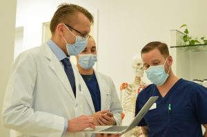 Medical professionals consult for holistic care