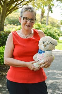 Carol Howell holds a teddy bear that her mother loved during her final days