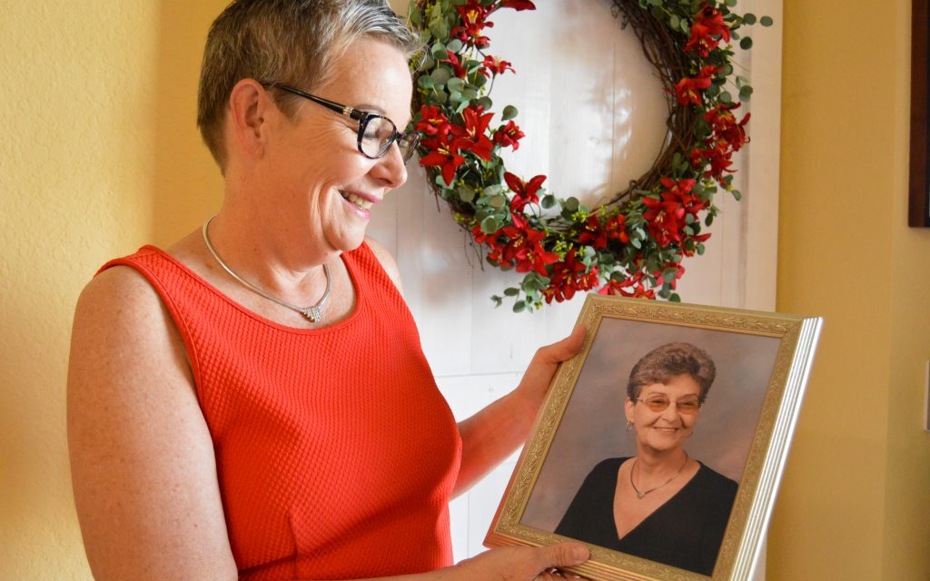 Carol Howell with a cherished portrait of her mother_ Vera Jean Holder