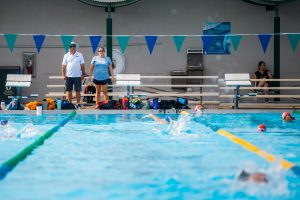 Gulf Coast Swim Team coaches Don Henshaw and Heather Fort oversee practice at the FGCU Aquatics Center