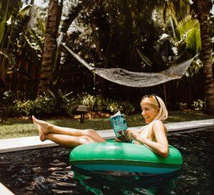 Tara Settembre enjoys poolside escape reading
